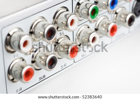RCA connections on the back of a DVD player - stock photo