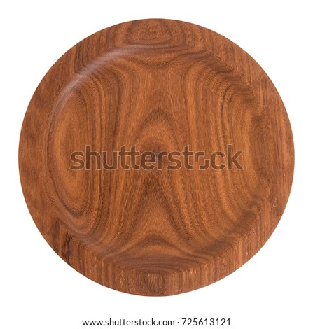 Re-purposed mahogany wood round plate. Hand crafted from recycled wood and isolated on white. Beautiful grain.