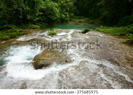 Reach Falls waterfalls and surrounding lush tropical rain forests not too far from Port Antonio are one of the most popular tourist destinations and attractions in Portland parish, Jamaica. - stock photo