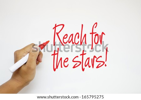 Reach For The Stars! sign on whiteboard - stock photo