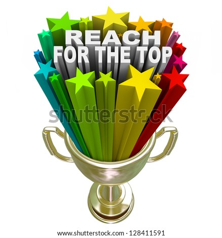 Reach for the Top words in fireworks and colorful stars shooting out of a gold trophy symbolizing winning a competition or game, or achieving personal success or a goal - stock photo