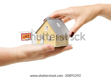 Reaching For A Home with Sold Real Estate Sign Isolated on a White Background.