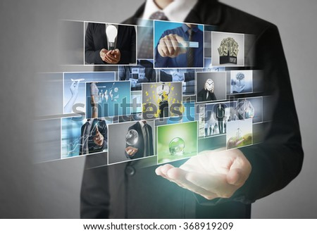 Reaching images streaming, digital photo album - stock photo