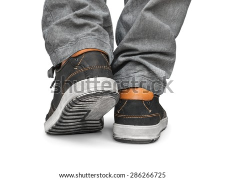 reaching leg men in gray jeans and street shoes isolated on white background - stock photo