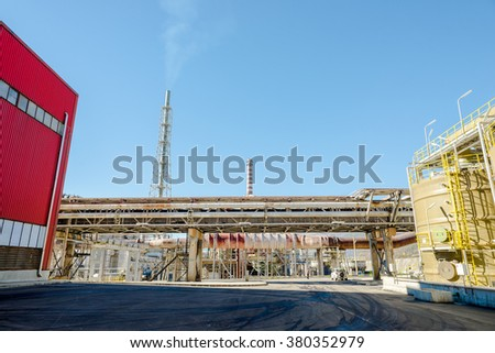 Reactor, chimneis and pipes, part of the working process in an industrial smelter, foundry factory AURUBIS, November 06, 2015. - stock photo