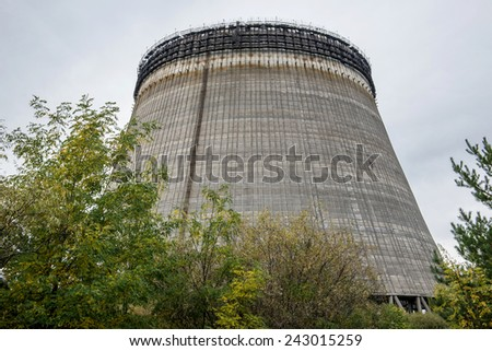 Reactor no. 5 cooling tower in Chernobyl Nuclear Power Plant Zone of Alienation, Ukraine - stock photo