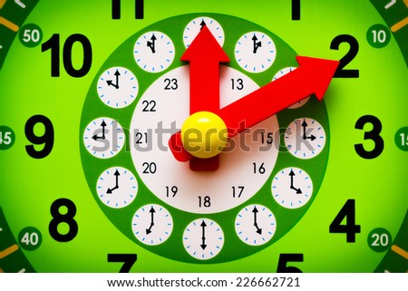 Read clock display with red yellow arrows closeup - stock photo