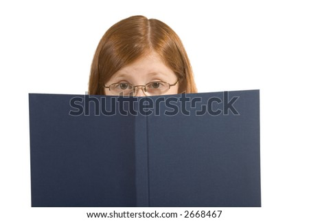 Read-haired Girl looking from behind the book