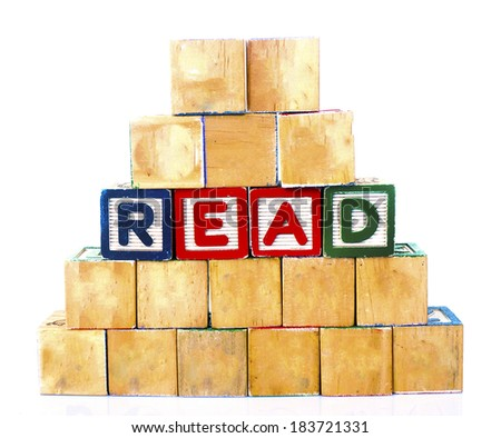 READ in alphabet wooden word blocks isolated on a white background                  - stock photo