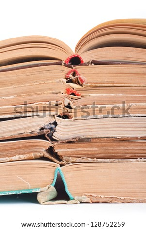 Read more! Big pile of open books isolated on white background. closeup - stock photo