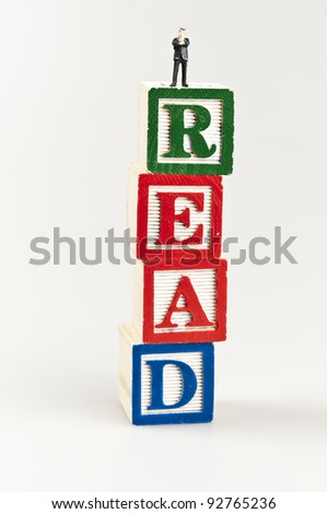 Read word and toy business man - stock photo