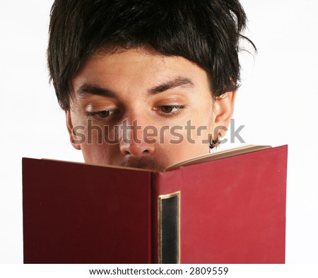 Reading a book. Boy face behind open book. Eyes focused on reading, education concept