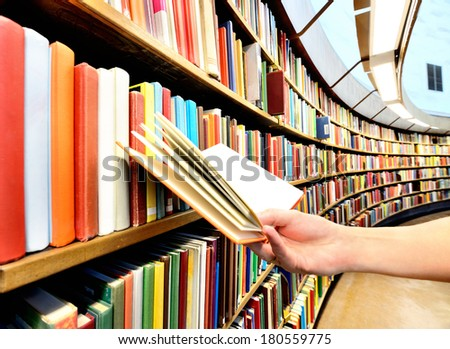 Reading a book in the library - stock photo