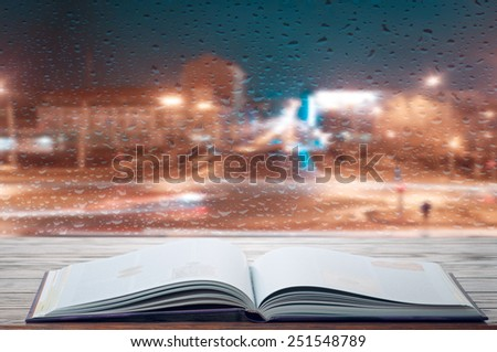Reading a book on rainy evening