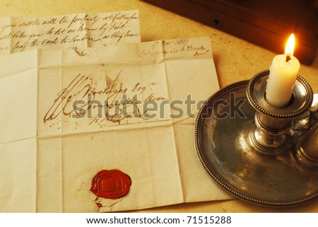 Reading a letter by candle light from 1800's - stock photo