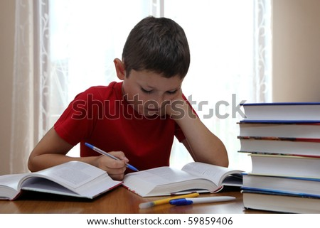 Reading book and doing homework - stock photo