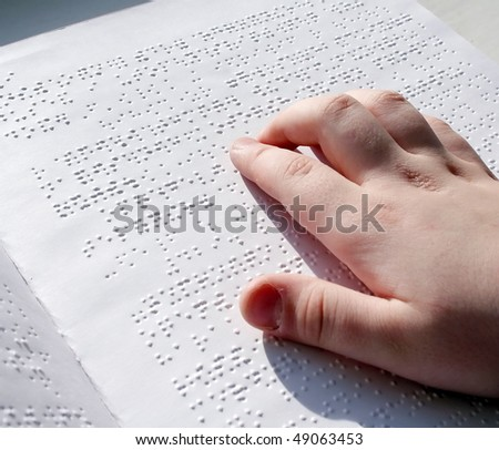 Reading books on Braille. - stock photo