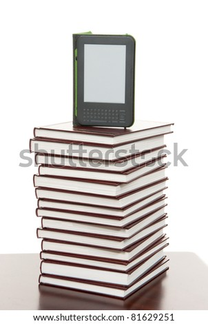 Reading digital ebook Device Display tablet Technology over stack of books - stock photo