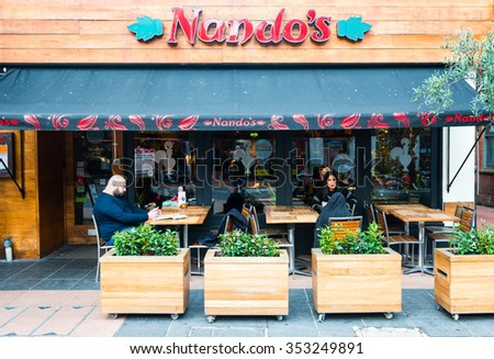 READING,ENGLAND-DECEMBER 19,2015:Nando's is an international casual dining restaurant chain originating from South Africa, with a Mozambican/Portuguese theme, founded in 1987. - stock photo