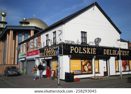 Reading,England - March 6, 2015: A polish delicatessen in Reading, England and the Abu Bakr Mosque. The migrant population of England has risen by 565k since 2011 according to the University of Oxford - stock photo