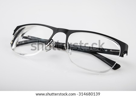 Reading eye glasses on white background - stock photo