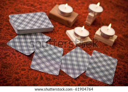 Reading Fortunes with Tarot Cards - stock photo