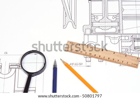 reading glass, pen and ruler at draft