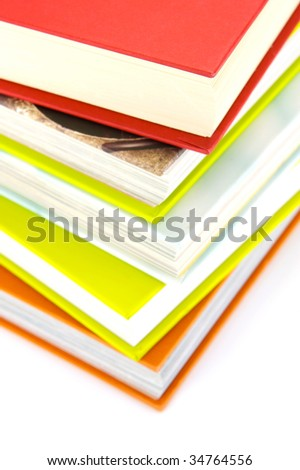 Reading glasses and books isolated against a white background