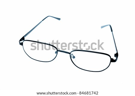 Reading glasses isolated over white - stock photo