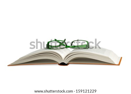 reading glasses on an open book on white background - stock photo