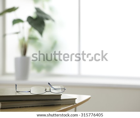 reading glasses on the table - stock photo