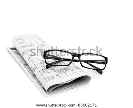Reading glasses sitting on a newspaper with a narrow depth of field.
