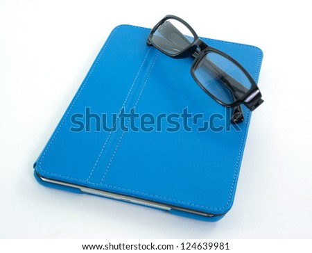 Reading glasses with blue leather folio case for tablet isolated on the white - stock photo