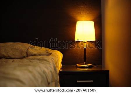 reading lamps in the bedroom near the bed. - stock photo