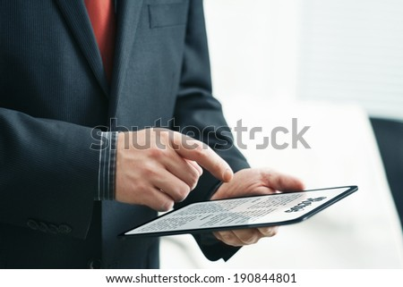 Reading News with Tablet Computer - stock photo