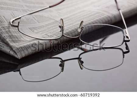 Reading newspaper and gathering stock news. - stock photo