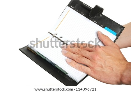 reading notes in a personal organizer isolated on white background
