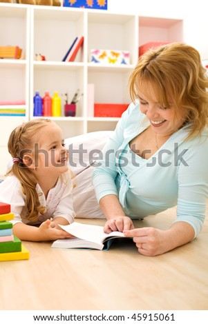 Reading stories is fun - little girl and woman having good time with a book