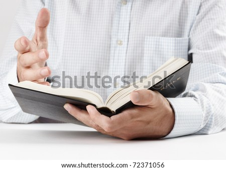 reading the Bible - stock photo