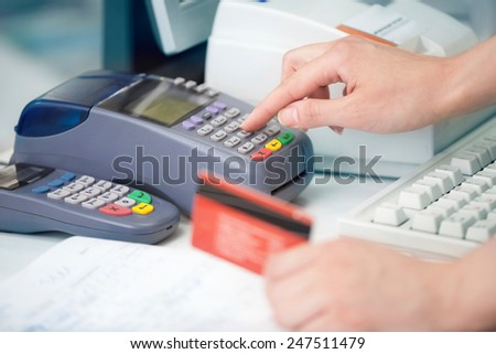 Reading the Credit card at the Credit Card Reader - stock photo