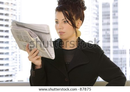 Reading the financial newspaper Sydney CBD - stock photo