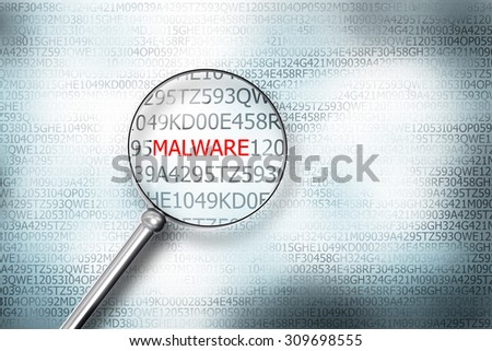 reading the word malware on digital computer screen with a magnifying glass internet security - stock photo