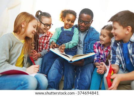 Reading with teacher - stock photo