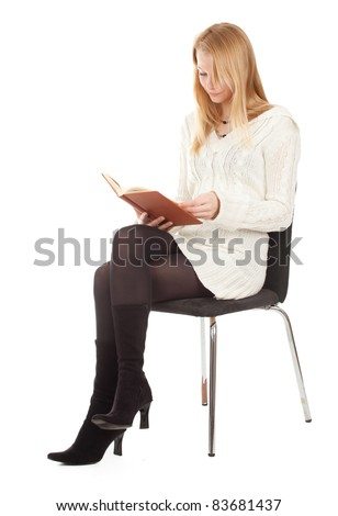 reading young blond hair woman with brown book sitting on chair - stock photo