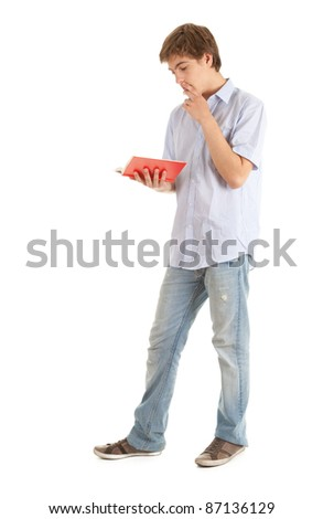 reading young male student with book, white background - stock photo