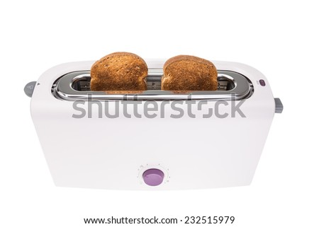 Ready crunchy croutons baked in a toaster. On a white background. - stock photo