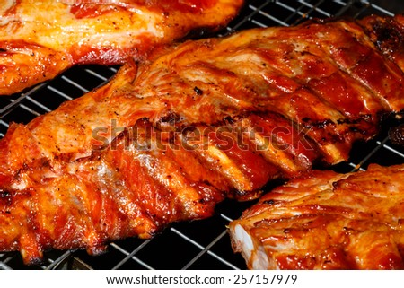 Ready food in the market in Thailand - edge pork on a grill - stock photo