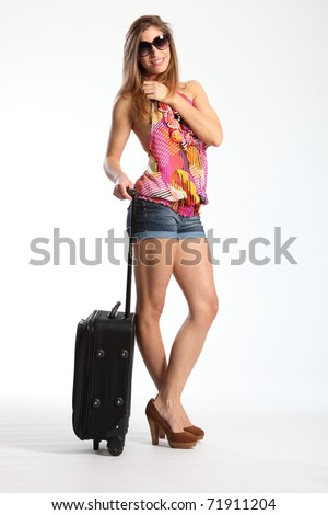 Ready for a holiday woman standing with suitcase - stock photo