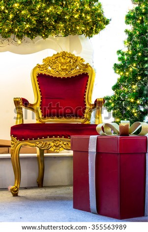 Ready for CHristmas,  Adorned Christmas Tree , Chair ,  Fireplace, Snowman, Gift  inside Living space with copyspace. /  Home Showcase Interior, CHRistmas Decoration on living space.