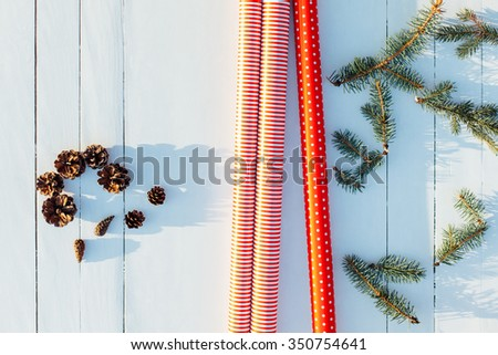 Ready for packing present with red paper on wooden table for Christmas, New Year, Birthday, Mother's day or Valentine - stock photo